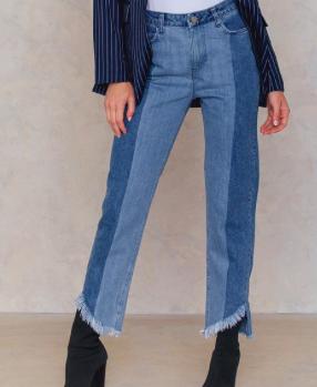 https://www.na-kd.com/en/qontrast-x-na-kd/asymmetric-hem-jeans--blue-combo